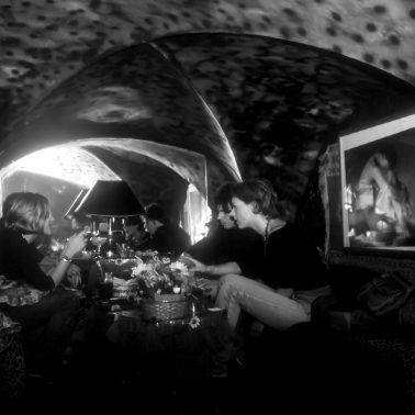 People seated at a table in a nightclub in Florence Italy