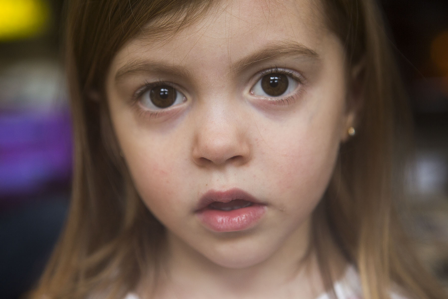 A portrait of a young girl, perhaps 6 years old. This a portrait of her face.