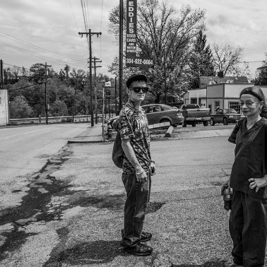 A man and a woman perhaps in their late 20s or early 30s who stopped to pose for a photograph in Clarksburg, West Virginia. circa 2014