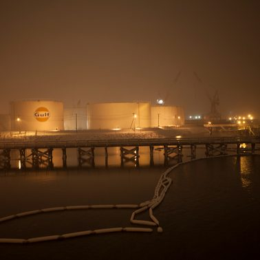 New Haven Harbor loading docks and gas silos at night