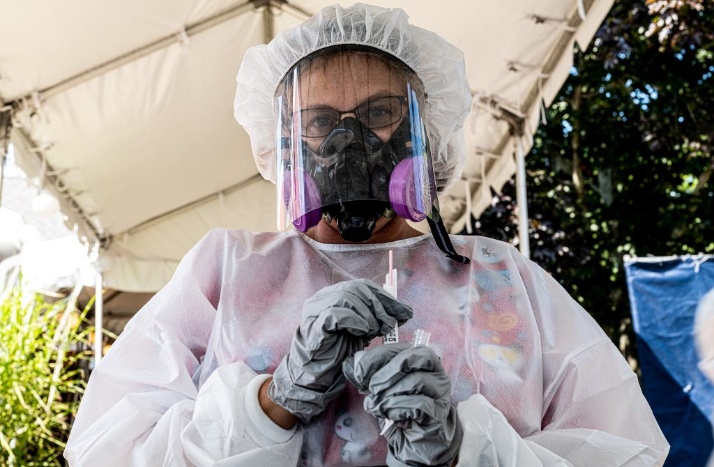 From the seat of myu car I photographed a woman in full protective gear. She was about to swab my nose for a Covid-19 test.