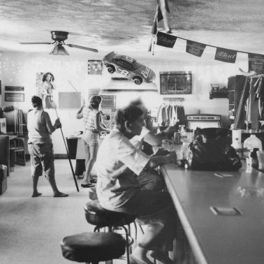 A bar in the Mojave Desert on a weekday afternoon. Women are drinking and playing pool.