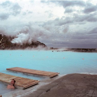 a man in a naturally heated lagoon in Iceland circa 1989